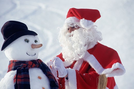 Santa Claus and snowman : Stock Photo