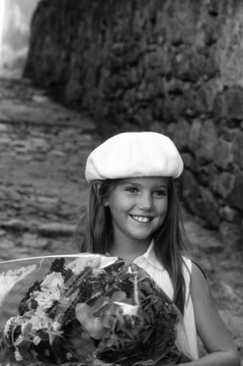Stock Photo: 1598R-131035 Girl (6-7) holding bunch of flowers (B&W)