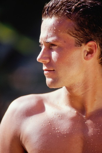 Stock Photo: 1598R-131987 Young man refreshed after showering, close-up