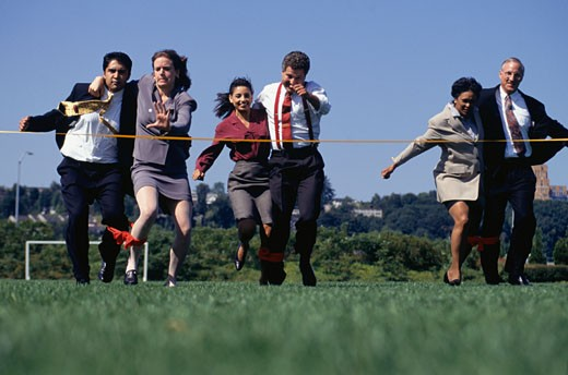 Stock Photo: 1598R-134931 6 businesspeople in three-legged race