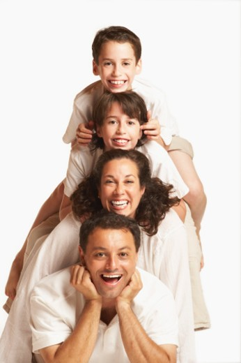 Portrait of a mid adult couple with their son and daughter : Stock Photo