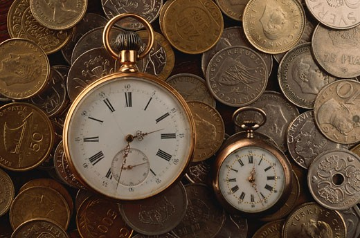 Pocket watch and collection of coins : Stock Photo