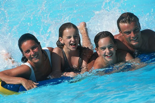 Family with children in swimming pool : Stock Photo