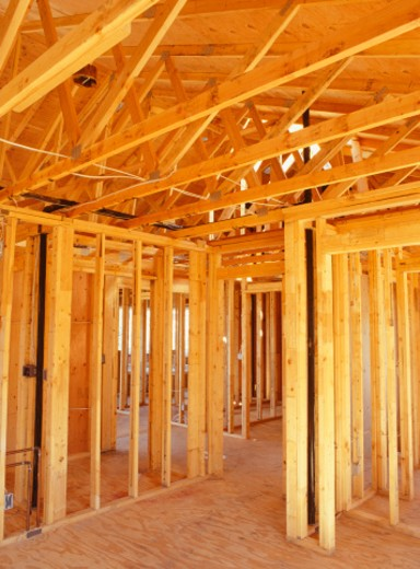Interior timber framework of semi-built house : Stock Photo