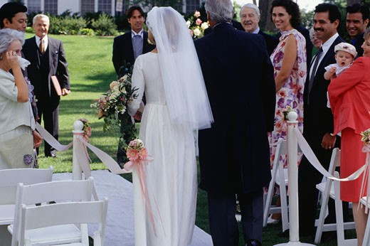 Bride and father walking down aisle at out door wedding ceremony : Stock Photo