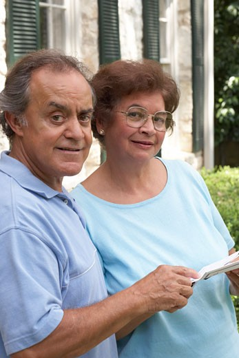 Portrait of a senior couple holding their mail : Stock Photo
