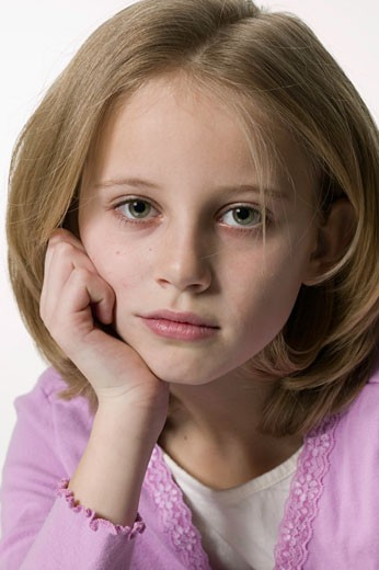 Young girl (10-11) looking at camera, posing, close-up, portrait : Stock Photo