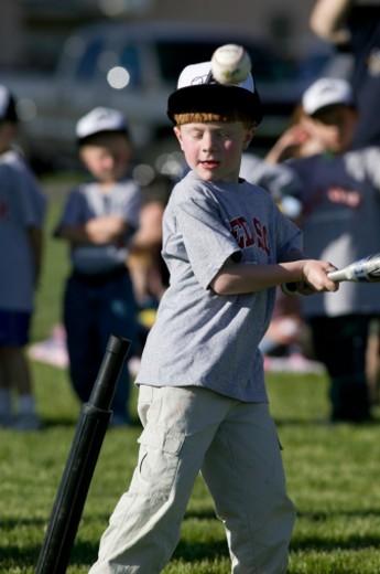 Stock Photo: 1598R-139796 Boys (6-7) playing baseball