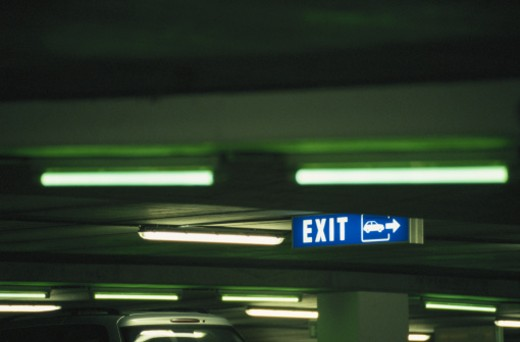 Exit sign' in car park (cross processed) : Stock Photo