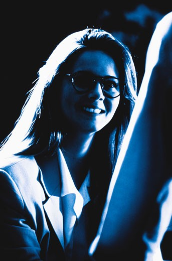 Businesswoman smiling (cross-processed) : Stock Photo