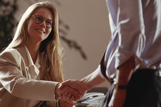 Stock Photo: 1598R-141425 Two business people shaking hands, close-up
