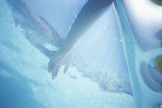 Hand underwater, close-up : Stock Photo