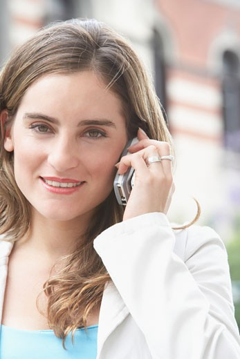 Portrait of a businesswoman talking on a mobile phone : Stock Photo