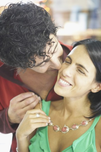 Stock Photo: 1598R-142218 Close-up of a young man kissing a young woman