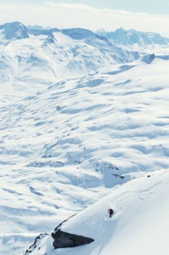 Skier on powdery mountains, aerial view : Stock Photo