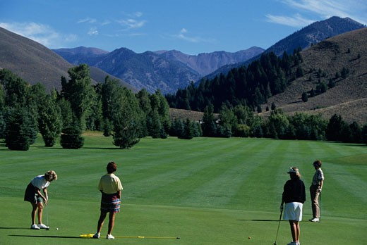 Stock Photo: 1598R-142990 Four women playing golf, Big Wood Golf Course, Sun Valley, Idaho, USA,