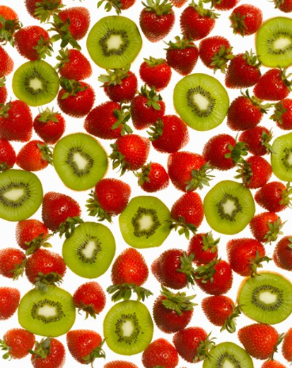 Strawberries and kiwi slices, full frame : Stock Photo
