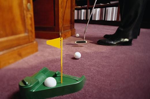 Businessman Putting Golf Balls : Stock Photo