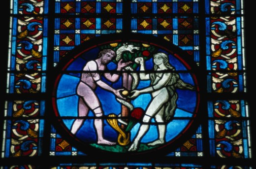 Stained Glass Depicting Adam and Eve : Stock Photo