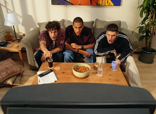 Three Men Watching Television : Stock Photo