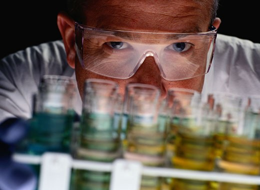 Scientist Examining Test Tubes : Stock Photo