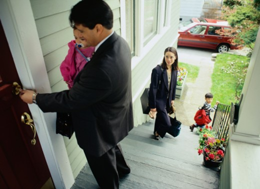 Family Leaving the House in the Morning : Stock Photo