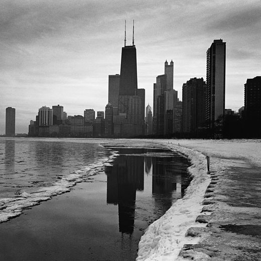 USA, Illinois, Chicago, skyline and lake shore, winter (B&W) : Stock Photo