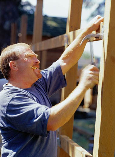 Stock Photo: 1598R-145769 Carpenter Building a Fence