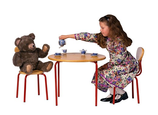 Girl Having a Tea Party With a Teddy Bear : Stock Photo