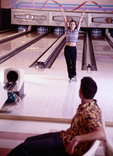 Stock Photo: 1598R-147030 Young Woman at a Bowling Alley