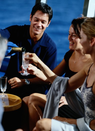 Vacationers in a Cocktail Lounge on a Cruise Ship : Stock Photo