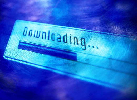 Stock Photo: 1598R-147570 The Word Downloading on Computer Monitor