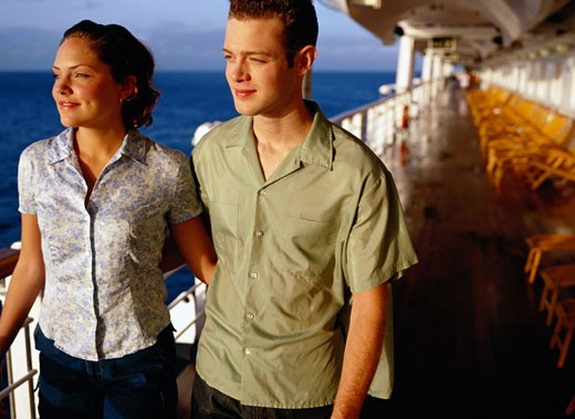 Stock Photo: 1598R-148776 Young Couple Walking on a Cruise Ship Deck