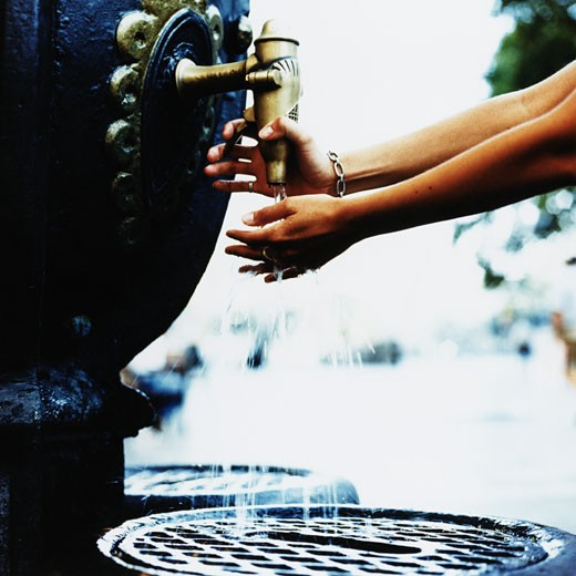 Stock Photo: 1598R-148906 Woman Washing Hands in Fountain, Barcelona