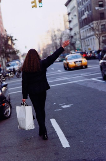 Hailing a Taxi : Stock Photo