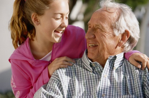 Grandfather and granddaughter (10-12) laughing : Stock Photo