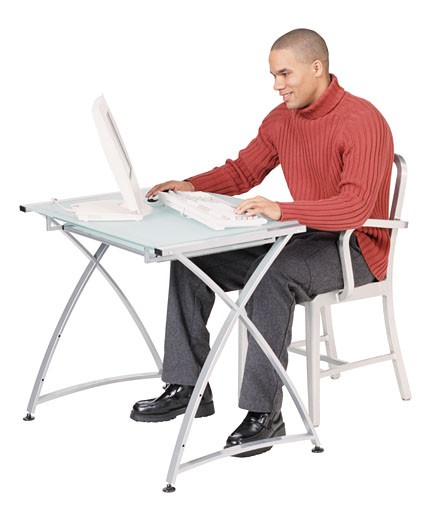 Man using computer at desk : Stock Photo