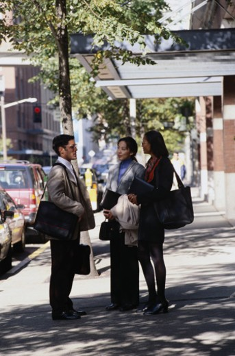 Businesspeople Talking on Sidewalk : Stock Photo