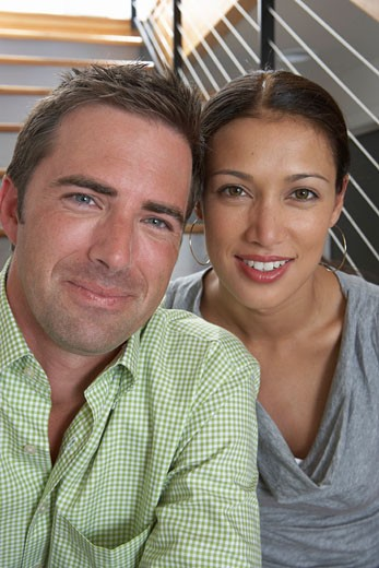 Stock Photo: 1598R-1568 Man and woman sitting on stairway, smiling, portrait