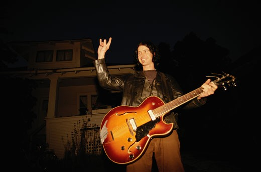 Stock Photo: 1598R-157968 Man Holding Guitar
