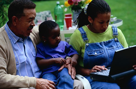 Grandfather with Grandson and Granddaughter : Stock Photo