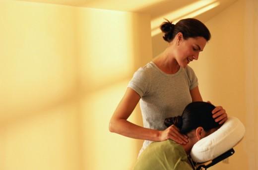 Stock Photo: 1598R-159417 Massage Therapist Giving a Neck Massage
