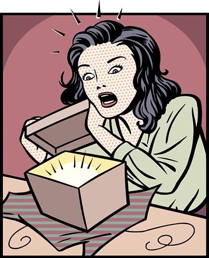 Shocked Woman Opening Gift : Stock Photo