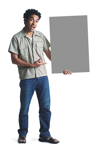 attractive african american man wears jeans short sleeved kahki shirt stands and holds a blank sign : Stock Photo
