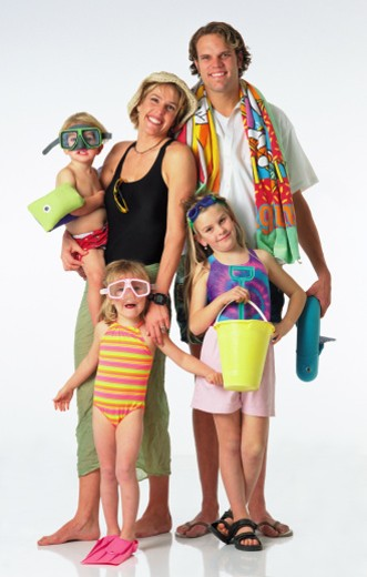 happy young blonde caucasian family of five in swimwear on vacation to the beach : Stock Photo
