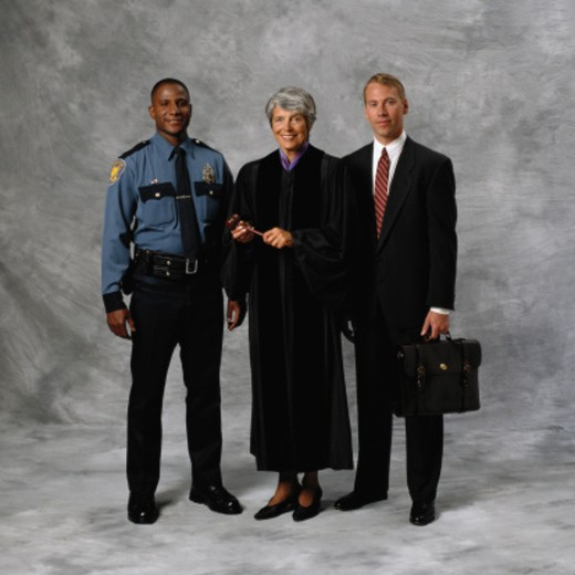 Stock Photo: 1598R-163389 Police Officer, Judge and Lawyer
