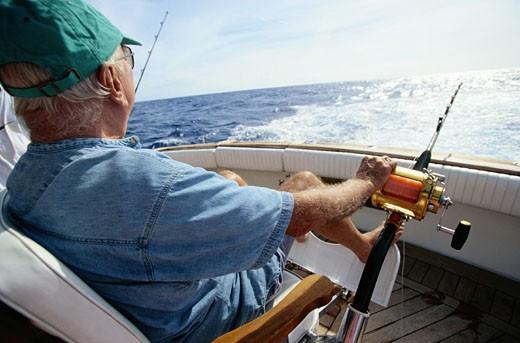 Stock Photo: 1598R-163776 Man Deep Sea Fishing