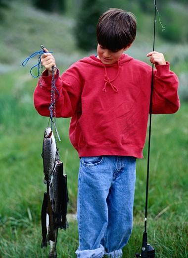 Stock Photo: 1598R-164068 Boy with Caught Fish