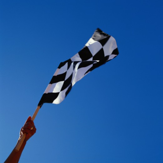 Stock Photo: 1598R-164093 Person Holding Checkered Flag