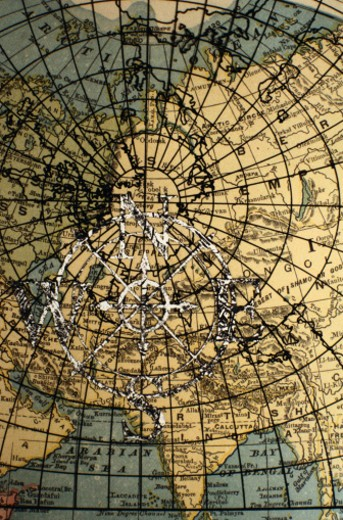 Compass Rose on a Detail of a World Map : Stock Photo